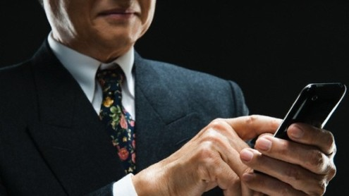 Senior businessman using smartphone